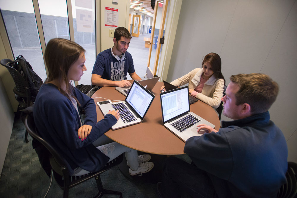 Students study in a breakout room at the School of Business