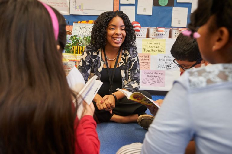 Student teacher Tracey-Ann Lafayette reads with second graders at Verplanck Elementary in Manchester