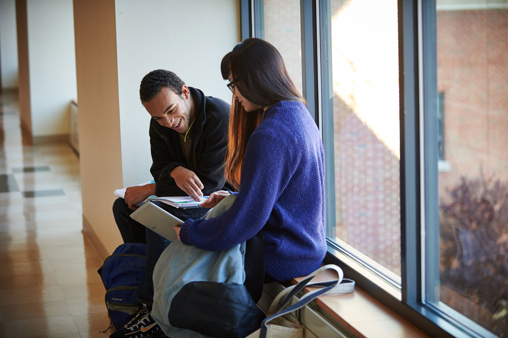 Students study near a window at the Waterbury campus