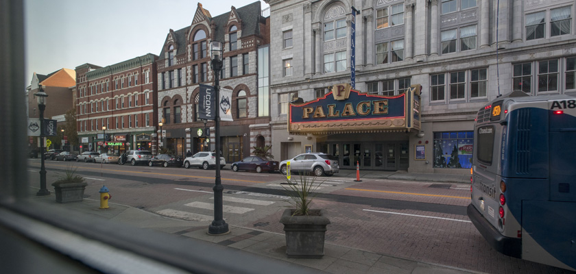 Students crossing the street in front of the Palace Theatre at UConn Waterbury
